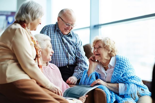 Group of seniors engaging in happy conversation