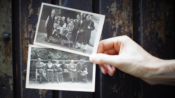 a picture of someone holding old vintage black and white photos