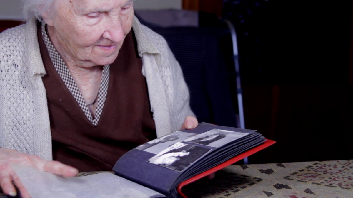 Older lady looking at a photo album