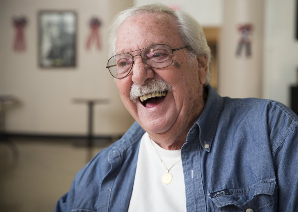 Elderly man laughing joyfully