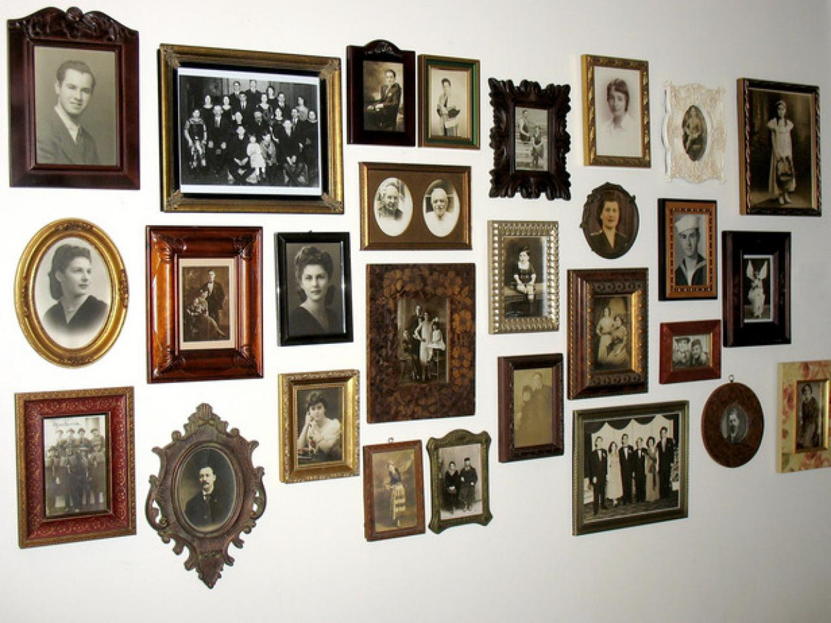 Wall of old timey photos in vintage frames