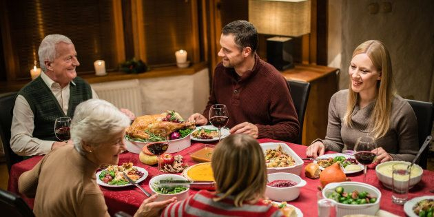 a family eating a holiday mean together at the table
